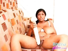 Kristina Milan playing with a huge sex toy