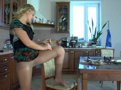 Blonde stunner spins by the mirror in her perfectly fitting sheer hose