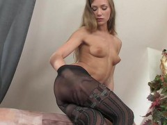 Strict looking office cutie disrobes to her mock hold-up tights and acquires wild