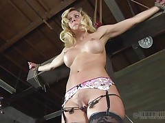 Hawt milf Cherie is all fastened up like Jesus Christ and is proud of her life experience as a whore. This babe has dents of whipping all over her tight abs and her snatch lips are tortured as hell. Her girlfriend is taken into a box from which she can not move at all and for sure she can not escape. Check it out!