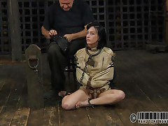 Sexy dark brown Elise is all bound up and shackled and sits obedient on the floor near to her executor who puts a mask on her face. This guy explains this s&m technique and what this babe is supposed to do. The floozy enjoys being the center of attention and waits for her thraldom treatment. Want to watch what happens to her?