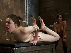 Brunette hair hair chick with beautiful face and sexy arse is getting whipped by this chick with big tits. She has laundry pliers on her toes and tongue and it looks like that chick enjoys the pain. After whipping her that chick begins fisting her oiled cunt 1st with one hand and then with both of them. Her slit barely takes it but that chick has to endure her treatment because she's tied up really good. When that chick finishes using her hands and a marital-device to fuck that pussy, the breasty chick begins to untie her, what's going to happen next?