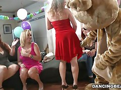 Stripper dances in front of those harlots and receives his hard dick sucked and licked by them. He's the dancing bear and the harlots are burning with desire for his hard penis. See how he gives his pecker to 'em and satisfy their need to suck cock? Maybe one of the harlots will receive favourable and receive a load on her face