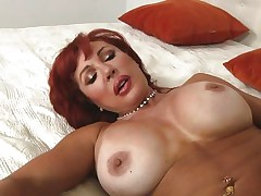 Her years of experience in fucking have a lot to say. Check out this gorgeous redhead milf and how lustfully this honey sucks and bonks cock. Damn the bitch knows how to drink a shlong and when this honey goes on top and rides this fellow we can clearly see her wet crack lips spreading. Yeah this milf needs some jizz deep inside her