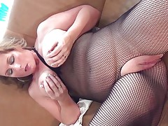 This sexy aged bitch with large round tits is sitting on the sofa wearing hose and this babe is playing with her boobs. This babe starts rubbing her large shaved pussy becoming very horny. The blond takes now a long sex-toy and starts riding it waiting the large agonorgasmos coming soon.