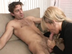 Milf gets on her knees to give irrumation