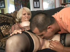 Aged blonde Sophie Mounds with wet pierced snatch