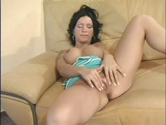 Busty Sabrina Dotee rubs her cleanly hairless pussy